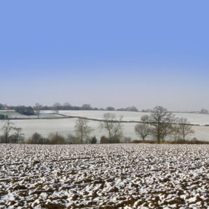 Godminster Farm in the snow ploughed fields